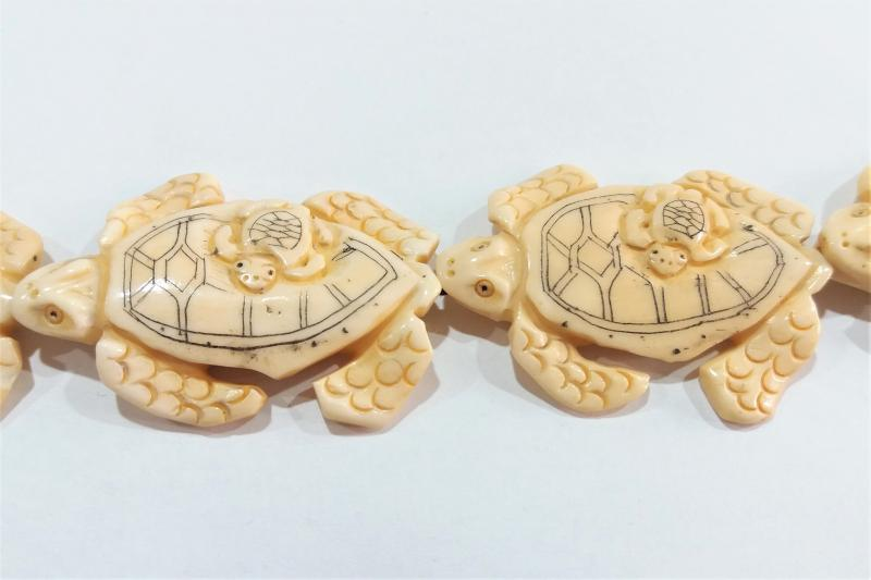 Hueso Figura de tortuga con hijo